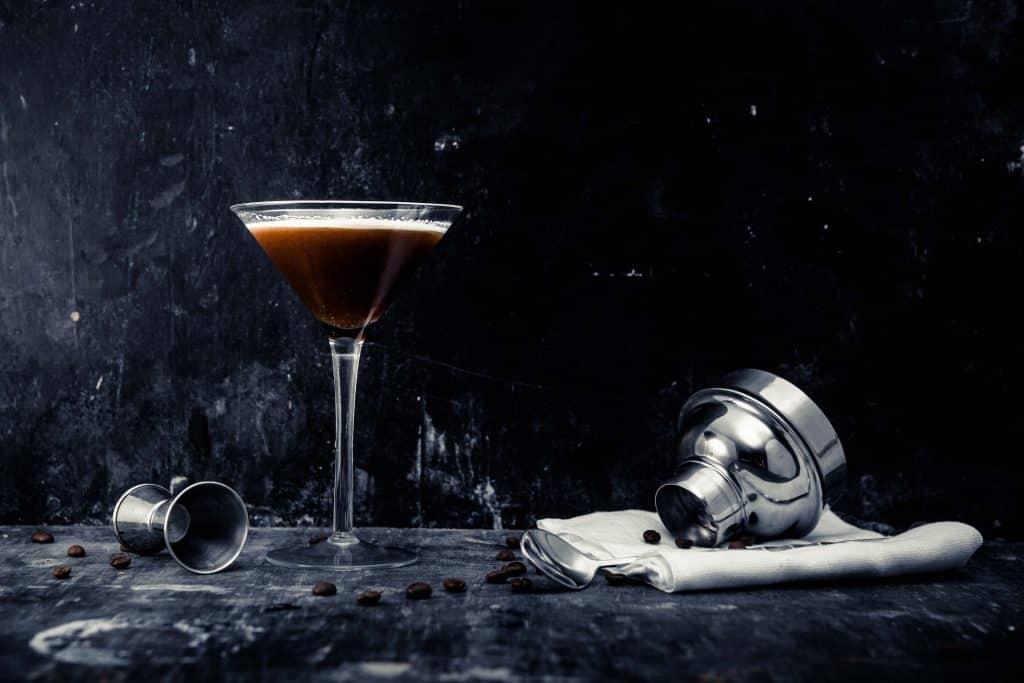 photograph of espresso chai martini with coffee beans