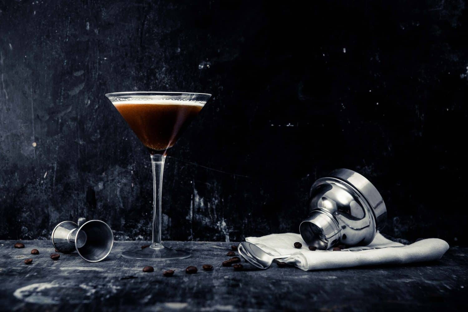 photograph of espresso chai martini with coffee beans