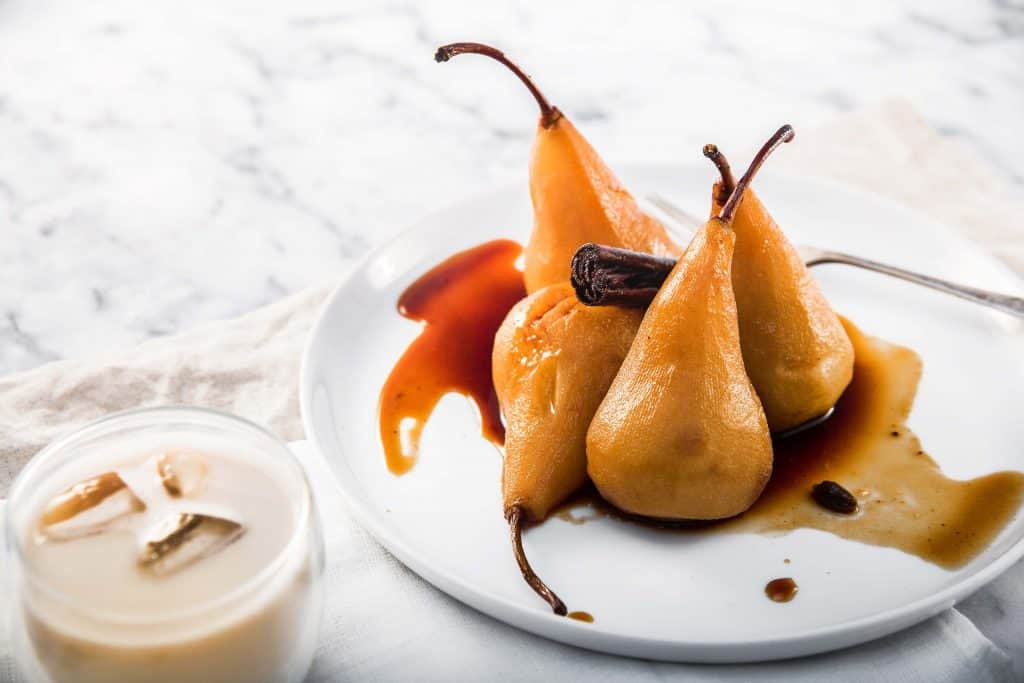 photograph of chai poached pears and a cup of iced chai latte