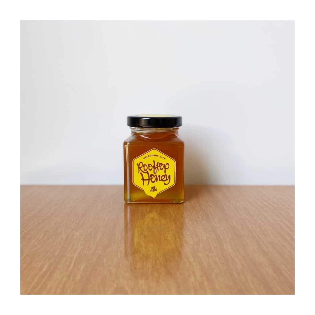 rooftop honey jar white background