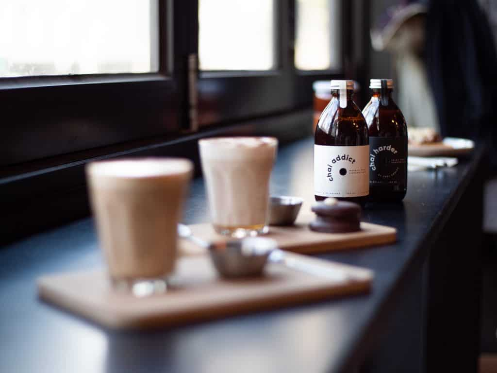 premade chai with bottles displayed in the background