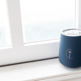 caye life cup by the window