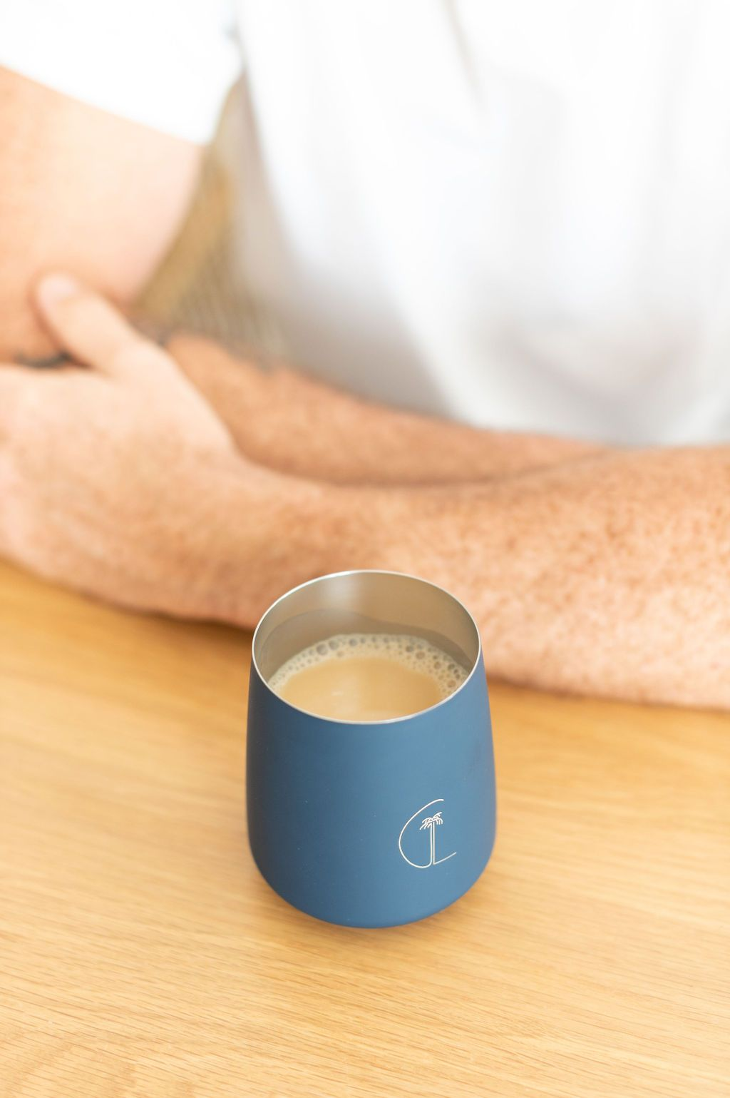 caye life cup with chai & man